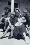 Family group on verandah of Le Chalet, Sark , 1949