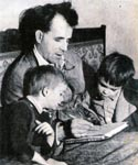 Sebastian and Fabian watch as their father draws something for them, Sark late 1940's